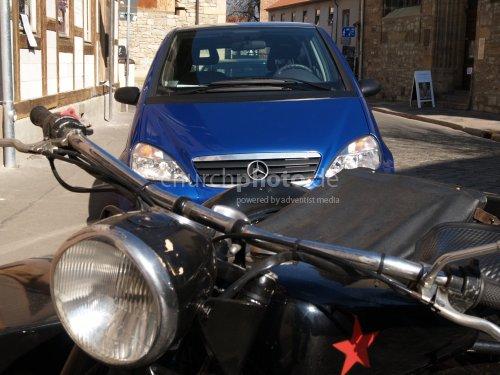 Old Bike and new Mercedes car