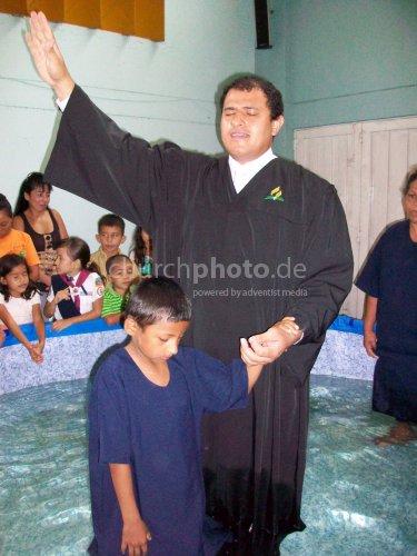 Pastor praying for new life
