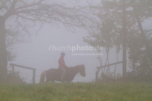 Rider in fog