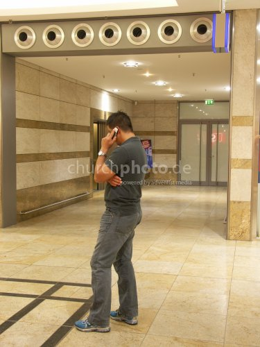 Man at the mobile phone