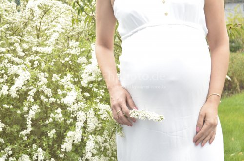 Pregnant belly with nature background