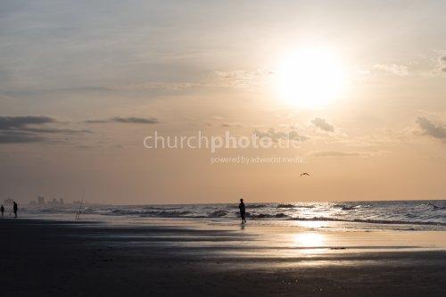 On a beach at sunrise