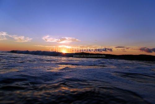 Morgens am Strand wenn die Sonne aufgeht