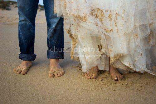 Bare feet on the beach